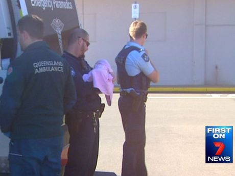 Police rescue a baby girl found locked in a car at a Toowoomba shopping centre.