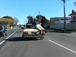 Car surfing caught on camera