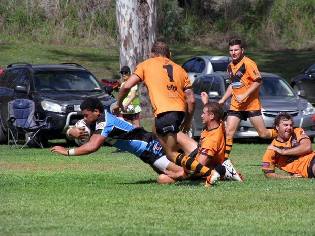 RUGBY: Moimoi Puli of South Kolan team scores a try against Avondale at Gin Gin. Photo: Zach Hogg / NewsMail