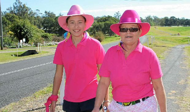GOOD CAUSE: Michelle Varley and Amy Hayne in the 2013 Lowood Slimmers Breast Cancer Walkathon.