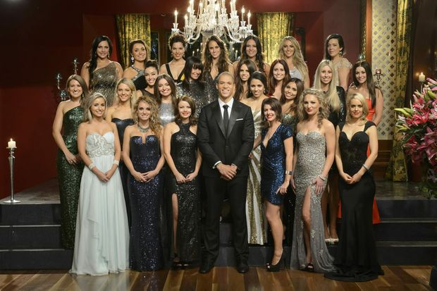 "Blake Garvey pictured with the 24 ""bachelorettes"" in a scene from the TV series The Bachelor Australia. Supplied by Network Ten."