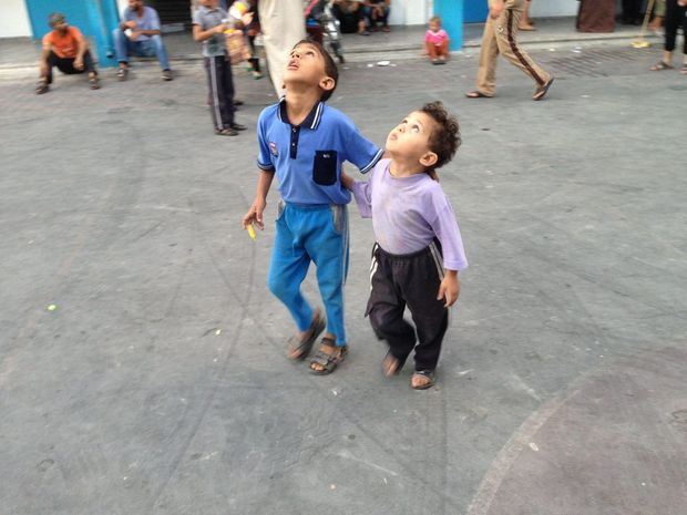 BROTHERS IN ARMS: Children in Gaza at one of the UN schools that was bombed by the Israelis.