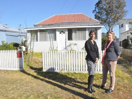National Trust of Queensland spokeswoman Stephanie Keays (left) and Cavell St resident Prue Rattray urge council not to allow the character-listed home to be demolished.