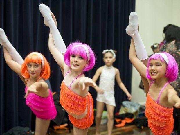 ( from left ) Sophie Pollock, Leah Stevenson and Bella Mills enjoy the eisteddfod.