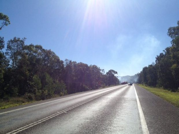 A large grass fire has forced emergency services to close the Sunshine Motorway.