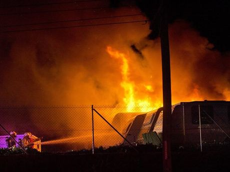 Fire destroys two caravans parked at a storage facility in Alderley St Toowoomba .