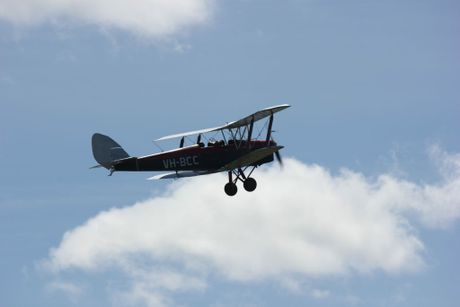 Al McVinish's De Havilland Tiger Moth soars high during a joyflight earlier this year.