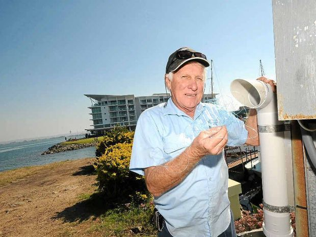 PROTECTING WILDLIFE: Regatta Avenue Boat Harbour Association secretary Ray McCombe with one of the fishing line disposal units installed at the Ballina harbour.