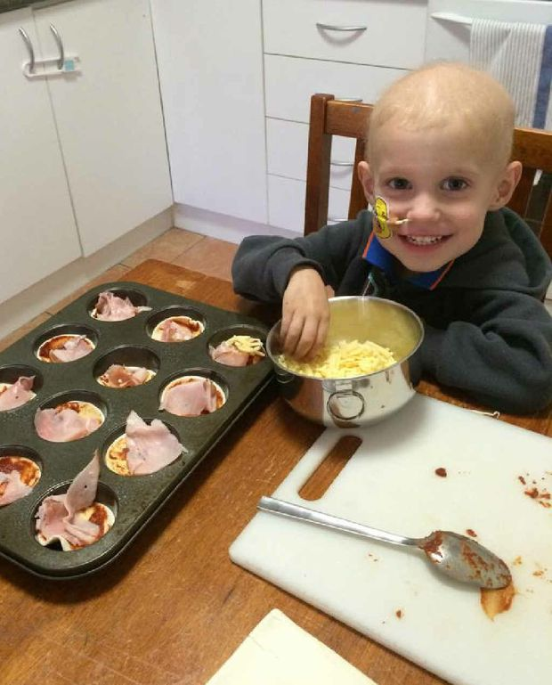 KICKING BUTT: Zane helps out with some cooking during a rare trip away from the hospital.