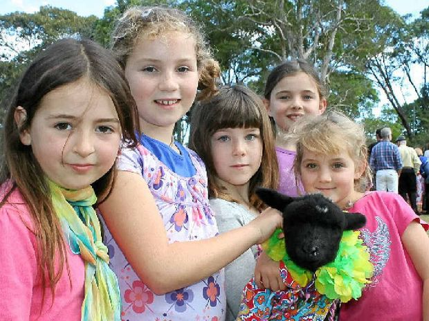 LITTLE LAMBS: Nacushla Bere, Chiara Brechbuhler, Paz Talbot-Kendall, Anouk, and Dakota Dennis with Elsie the lamb.