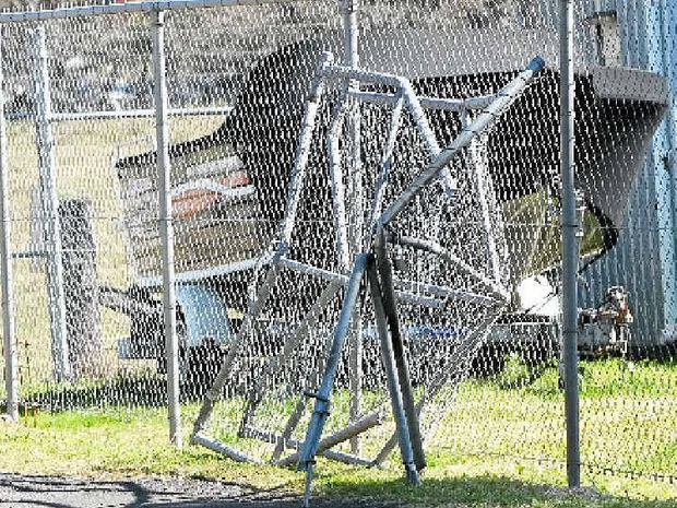 LOW SPEED PUSUIT: The front gate destroyed after a forklift was stolen and driven through the fence at Lismore Tractor & Machinery on Sunday evening in North Lismore.