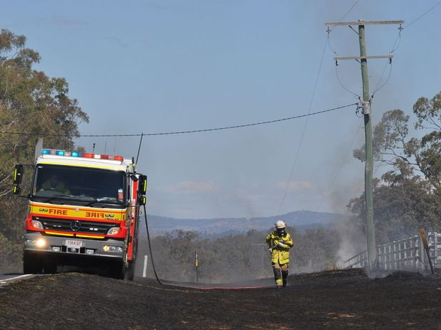 Fire crews bring a grass fire on Warwick-Allora Rd under control.