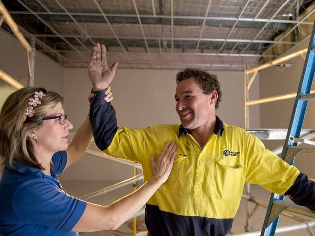 Jackie Robertson, physiotherapist checks out carpenter Will Todd on the job.