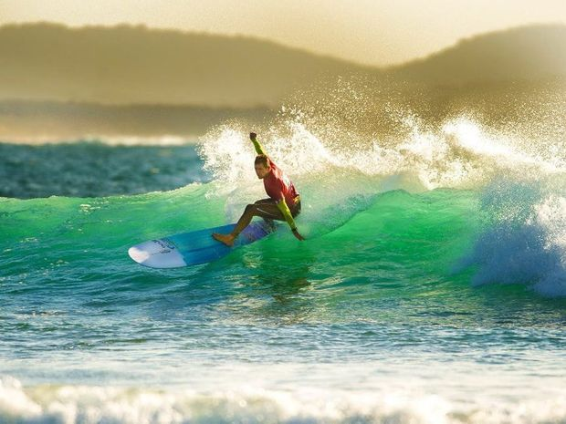 Harley Ingleby during yesterday's Open Longboard finals at the Australian Surf Festival off Arrawarra Headland.