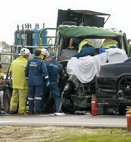 Rescue workers attempt to free Shane Shorten after the crash.