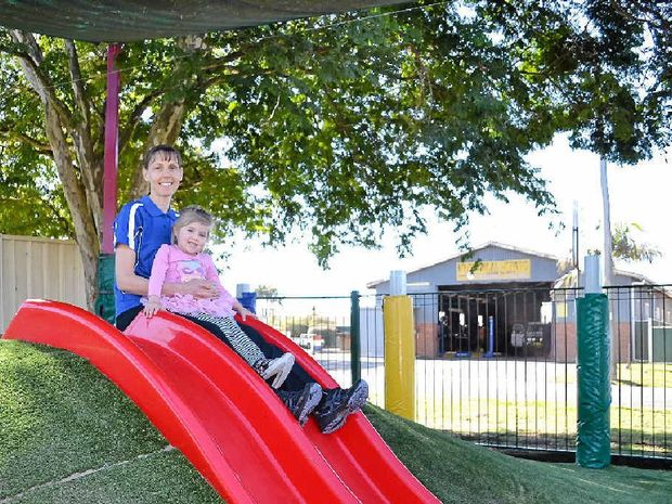 PLAYGROUND UPGRADE: Kookaburra Early Learning Preschool staff member Yvonne Bond and Zahlia Hanson, 3, are excited to have a new slide and new bollards along the fence.