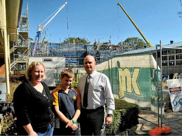 SKY HIGH: Gladstone State High School's new three-storey building will be ready for next year's influx of Year 7 and 8 students. Year 8 teacher Trish Whitfield, Year 8 student Isaac, 12, and acting principal Mark Law.