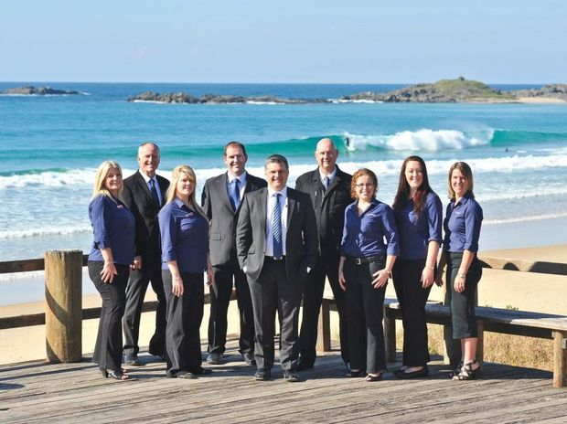 NOMINATION FOR EXCELLENCE: Atkinsons Real Estate managing director Martin Wells (centre) and his sales and property management team have been nominated for a REINSW Award for Excellence. Photo: Rob Wright