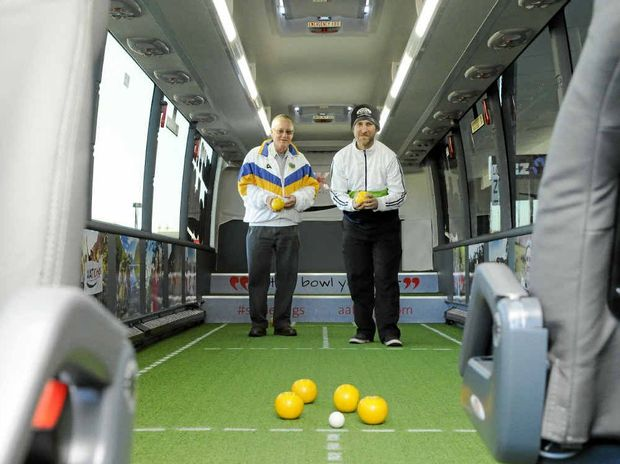 BOWLING THEM OVER: AAT Kings tour provider brought a mobile bowls green to Grafton Shoppingworld's carpark on Tuesday. Having a go at the internal green were Robert Ulrick (left) and Leslie Smith. Photo: Debrah Novak