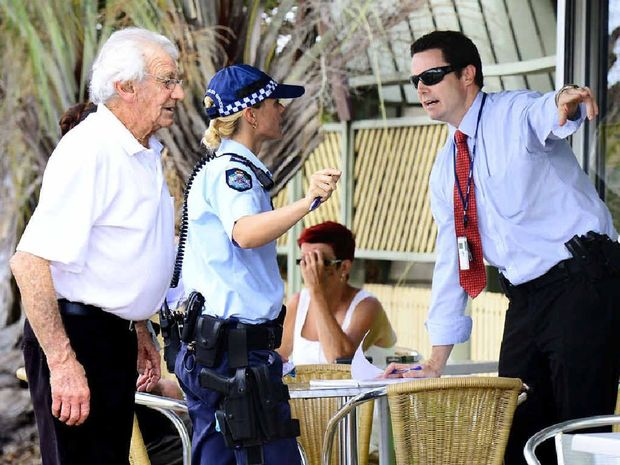 PROACTIVE: Uniformed officers and detectives investigate a recent armed robbery at North Ipswich.