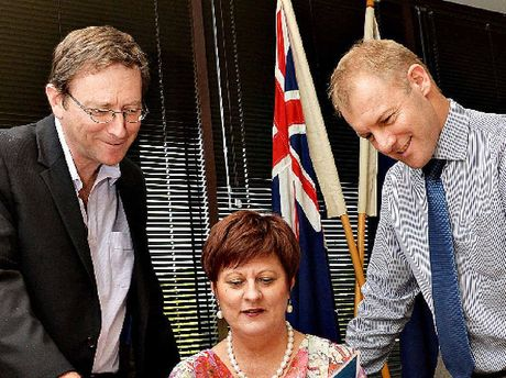 COLLABORATION: NQBP's Jeff Stewart-Harris, Mackay Mayor Deirdre Comerford and Mackay Sugar CEO Quinton Hildebrand look over the submission.