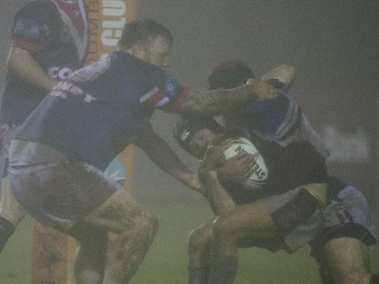 TOUGH TO HANDLE: The Warwick defence tries to tackle Dalby hooker Danny Wassell in the TRL elimination semi-final.