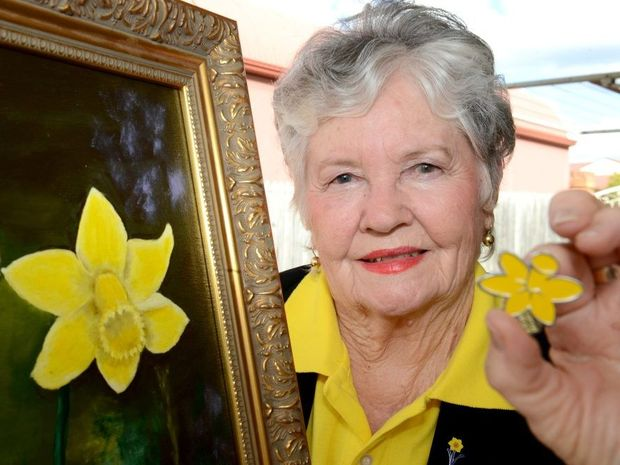 GOOD CAUSE: Joan Jones selling Daffodil Day merchandise to raise money for the Cancer Council in memory of her late husband Maurice Jones.