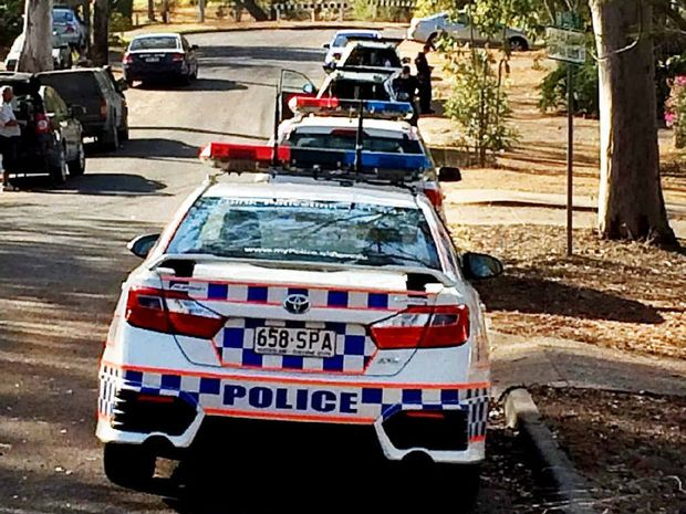 RAID: Police converge on a house in Goodna during Operation Lima Quantity.
