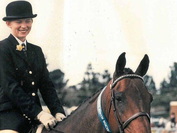 IN WINNER'S CIRCLE: Alex Rowe wins in equestrian sport.