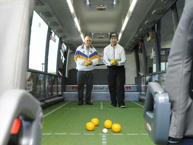 AAT Kings tour provider brought a mobile bowls green to Grafton Shopping World's carpark on Tuesday. Having ago at the internal green were Robert Ulrick (left) and Leslie Smith. Photo Debrah Novak / The Daily Examiner