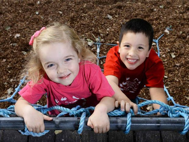 CARING PLACE: Lucy Day and Keegan Kamoto at the Jacaranda kindy in Booval which is celebrating its 35th anniversary this month.