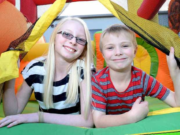 FREE EVENT: Olivia ,11, and Jacob Reid, 6, try out the jumping castle ahead of Vision Christian Church's Funday Sunday in Booval.
