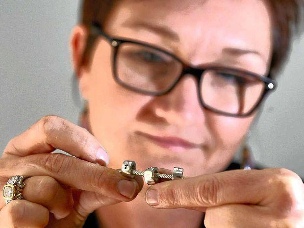 GOLDEN MEMORIES: Jeweller Rita Williams of Sunstate Jewellery with a memento bead.