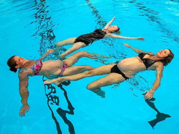 BUMP CLASS: Mothers-to-be Bree Shaw, Sarah Winters and Tamara Simoneau at the Kawana Aquatic Centre.