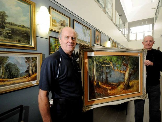 LASTING TRIBUTE: Richard Jux office manager of the Lismore Base Hospital oncology unit and artist Jim Hourigan, with the latest paintings in the foyer of the cancer unit.