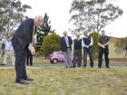 Mayor Paul Antonio tees off at Wilf Gowlett detention basin in South Toowoomba, where the City Golf Club plans to build a driving range.