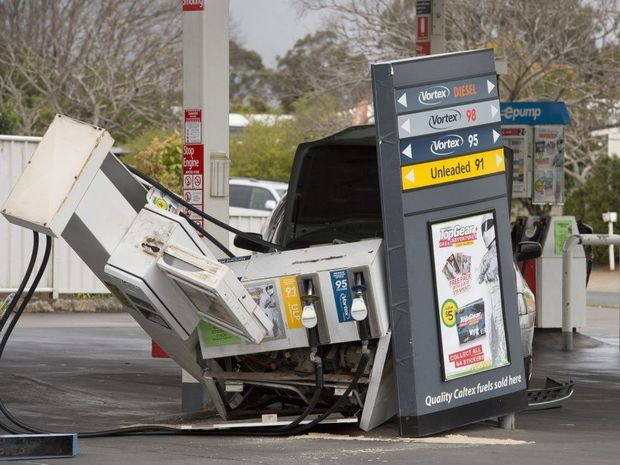 Car hits petrol bowser at Caltex Woolworths petrol station at Wilsonton.