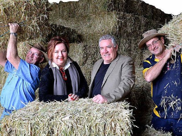 BUY A BALE: Gympie Cooloola Rotary members are passing goodwill round this Muster, with Rotary's Wally Emerson backing the Buy a Bale campaign, along with Muster officials Judy Arthur and Jeff Chandler and Rotary's Colin Stone.