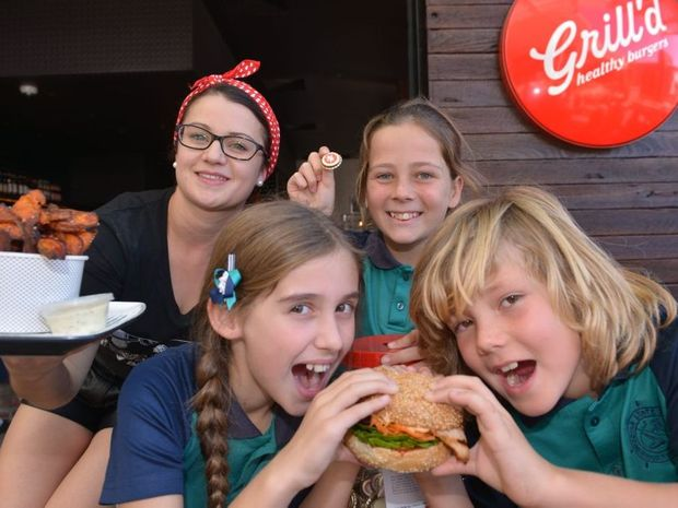 MINDFUL EATING: Buddina State school students, Willow, Grace and Steel at Grill'd, Kawana with Laura Peres.