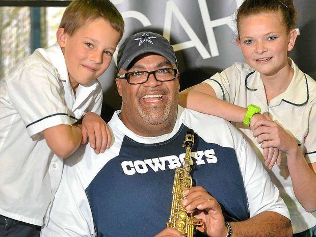 IT'S YOUR FUTURE: US-based motivational speaker Reggie Dabbs with Burnside State High School students Corben McCosker and Kiara Shepperd.