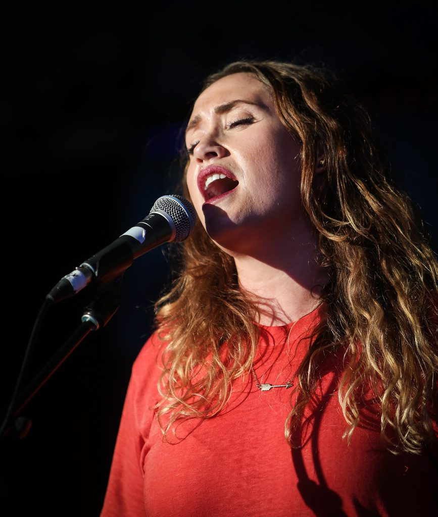 Brisbane singer-songwriter Nat Dunn belts out one of her EP hits at the Village Festival in Yeppoon. Photo Allan Reinikka / The Morning Bulletin