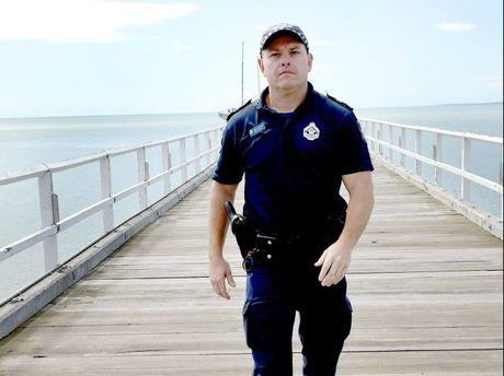 Senior Constable Mick Bleakley patrolling the Urangan Pier.