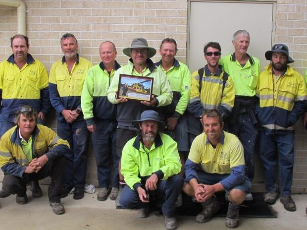 Clarence Valley Council Townend depot staff with their certificate of thanks. Photo: Contributed.