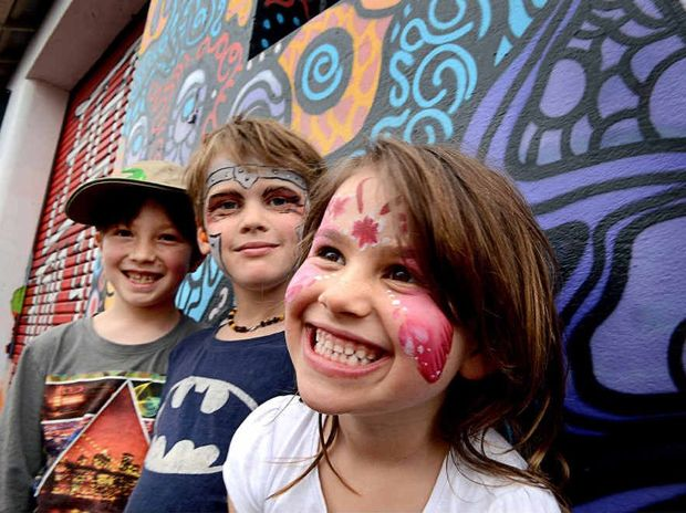 PARTY TIME: Istvan Kohary, 8, Oscar Nissen, 7, and Honey Moon Nissen, 5, all of Tuntable Creek, enjoy the Back Alley Gallery party on Saturday.