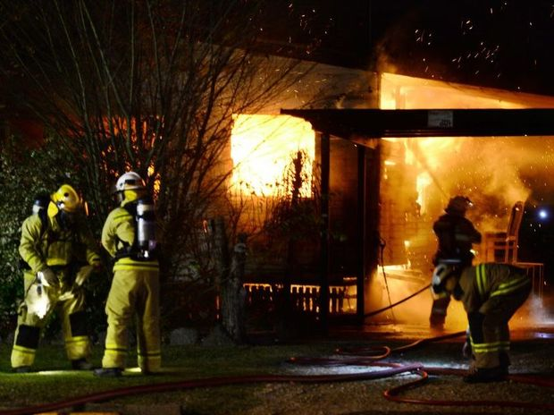 DAMAGE DONE: Firefighters tackle a Chubb St house blaze in One Mile early yesterday morning.