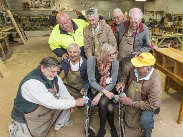HELPERS: Les McGill of the brewery complex, Steve McKimm, Bob Cuming, David Abrahams with (front l-r) Brian Carter, Frank Heppell, Palliative Care CNC Petra Quante and Warren Moss with a restored wheelchair. Photo Adam Hourigan