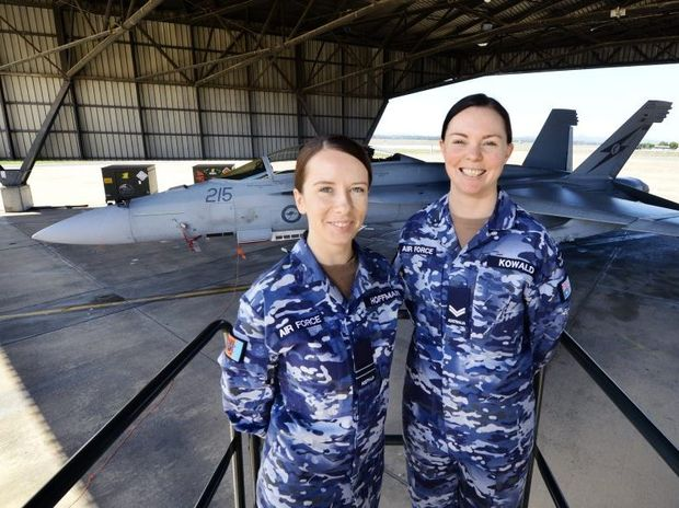 HIGH FLYERS: Dominique Hoffman and Jenna Kowald model the new RAAF uniforms at RAAF Base Amberley on Tuesday.