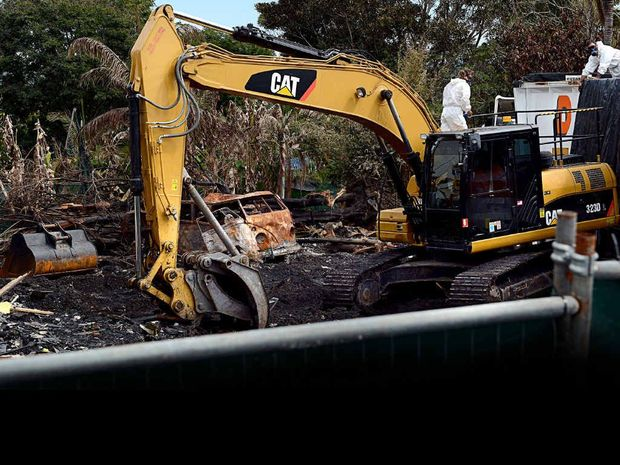 CLOSURE: Crews begin the demolition of the businesses destroyed by fire in Cullen St, Nimbin.