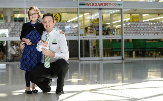 CALL FOR SUPPORT: Charlotte Broady, with Woolworths service manager Matt Puxley, is the face of the Ipswich region's Woolworths Children's Hospital Foundation appeal.