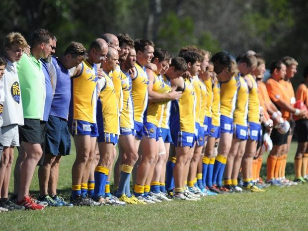 AFL Wide Bay grand final - N.E McLean Oval, Hervey Bay - Players from Across The Waves and Hervey Bay Bombers form a line to sing the national athem before the match.